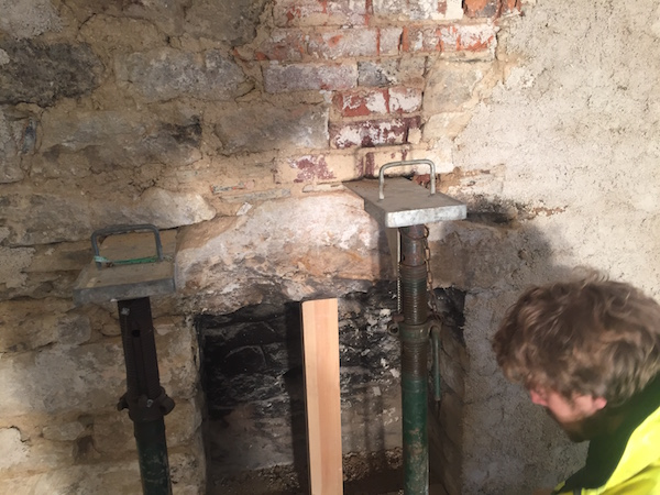 After removing the old render we uncovered An original fireplace.