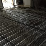 Fitting Under floor heating limecrete flooring in St Buryan Cornwall